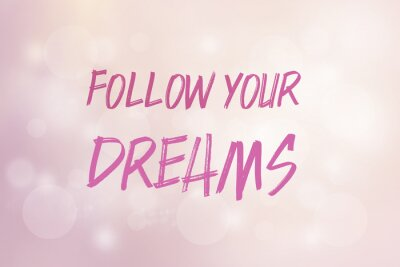 Phrase follow your dreams on a pink background with shiny bokeh and bright light