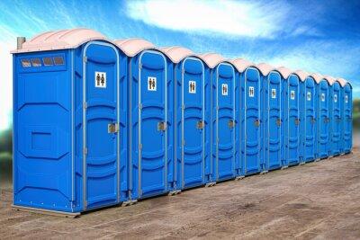 Papiers peints Portable plastic toilets in a row.