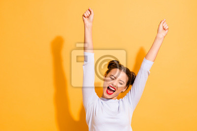 Papiers peints Portrait of her she nice-looking attractive lovely winsome sweet cheerful cheery optimistic girl having fun rejoicing raising hands up party isolated on bright vivid shine yellow background