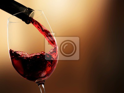 Papiers peints Pour red wine on blurred background