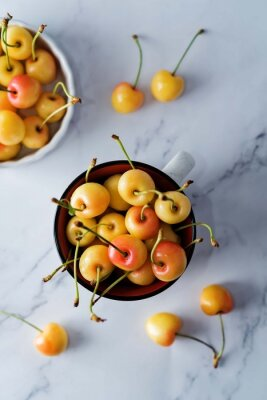 Raw fresh cherries on a light background