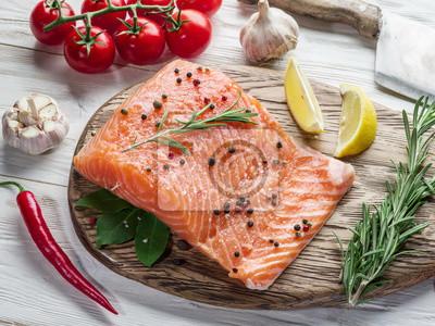 Raw salmon on the cutting board.