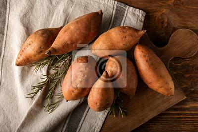 Papiers peints Raw sweet potato on table
