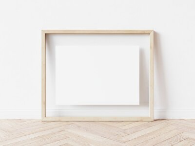 Papiers peints Rectangular wooden picture frame with thin light border and white background standing on wooden floor. 3D Illustration.