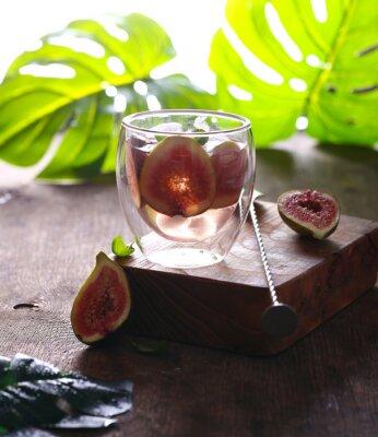 refreshing fig lemonade with ice and fresh berries