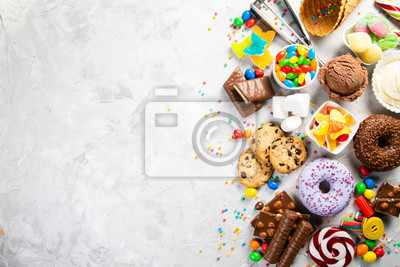 Papiers peints Selection of colorful sweets - chocolate, donuts, cookies, lollipops, ice cream top view