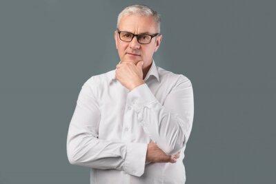 Papiers peints Senior pensive man portrait on gray background