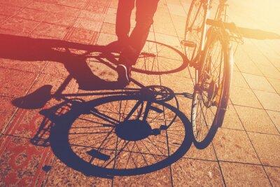 Papiers peints Shadow on Pavement, Man Pushing Bicycle
