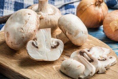 Sliced raw mushrooms.