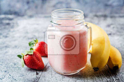 Strawberry banana smoothies in glass