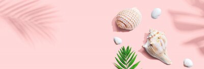 Papiers peints Summer concept with seashells and a palm leaf