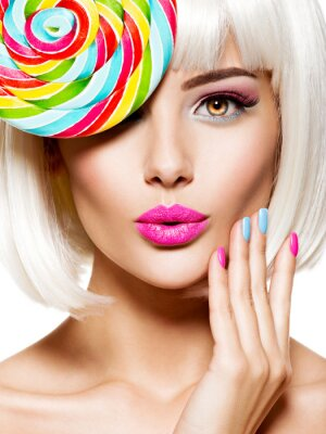 Papiers peints Surprised face of a pretty woman  with multicolor nails and pink lips
