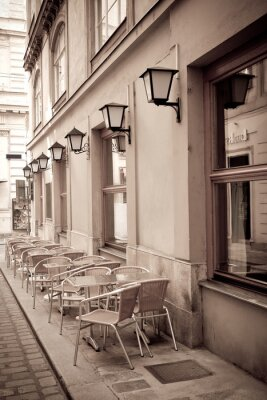 Papiers peints Tables et chaises dans un café