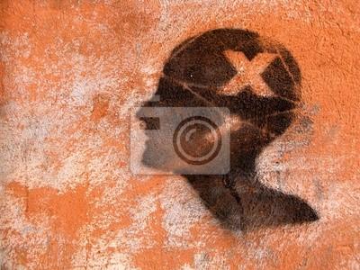Mur Ocre tête noire graffitée sur un mur ocre. papier peint • papiers peints