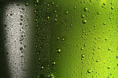 Texture de gouttes d'eau sur la bouteille de bière.