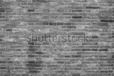 Papiers peints Texture de mur de brique grise.
