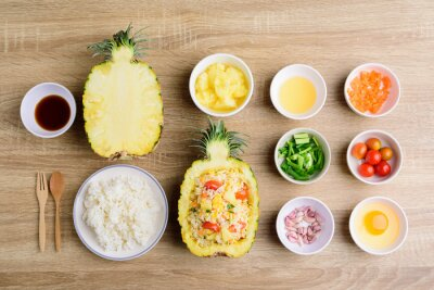 Thai food, pineapple fried rice and recipes for cooking on wooden background, vegetarian food