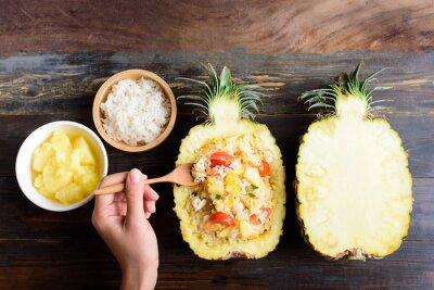 Thai food, pineapple fried rice in pineapple fruit bowl, vegetarian food