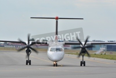 Papiers peints This is a view of Eurolot plane Bombardier Dash-8 Q400 registered as SP-EQC on the Warsaw Chopin Airport. July 30, 2015. Warsaw, Poland.