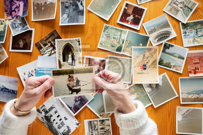 Papiers peints Top view of a senior caucasian woman looking at an old photos themes of memories nostalgia photos retired