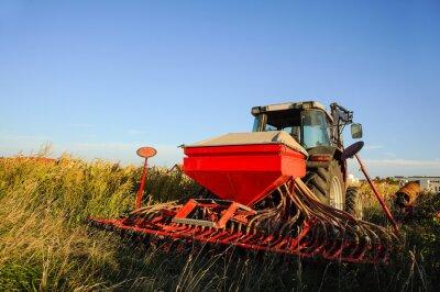 Papiers peints Tracteur avec semeuse sur le terrain