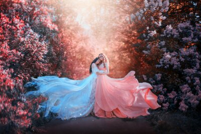 Papiers peints two women in long dresses hugging train flies wind. bright fabulous purple colors art retouching processing. Natural cosmetics scented spring flowers tenderness smell perfume. Blonde brunette hair