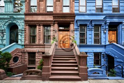 Papiers peints une vue d'une rangée de brownstones historiques dans un quartier emblématique de Manhattan, à New York