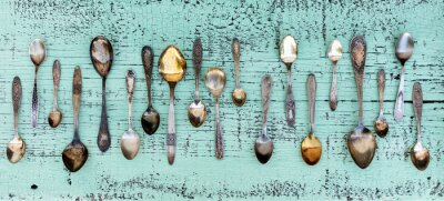 Papiers peints Vintage cutlery - spoons, forks and knives on an old wooden background.