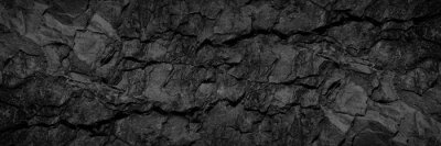 Papiers peints Volumetric rock texture with cracks. Black stone background with copy space for design. Wide banner.
