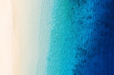 Papiers peints Waves as a background from top view. Azure water background from drone. Summer seascape from air. Gili Meno island, Indonesia. Travel and vacation image