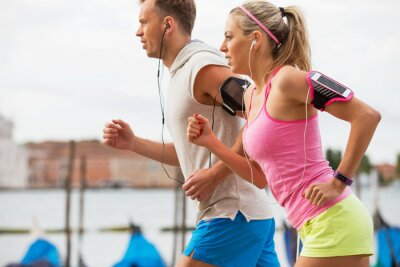 Papiers peints Woman and man running outdoors together