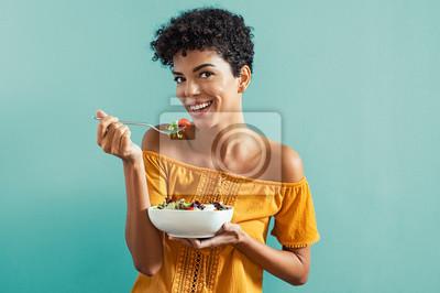 Papiers peints Woman eating salad