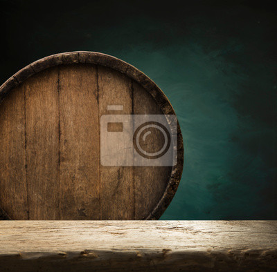 Wooden barrel on a table and textured background