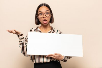 Papiers peints young latin woman open-mouthed and amazed, shocked and astonished with an unbelievable surprise