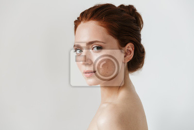 Papiers peints Young redhead woman posing isolated over white wall background.