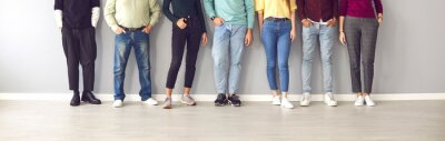 Papiers peints Your shoes says a lot about you. Cropped image of the legs of people in ordinary clothes and shoes standing in a row near the wall. Concept of diverse people in modern business.