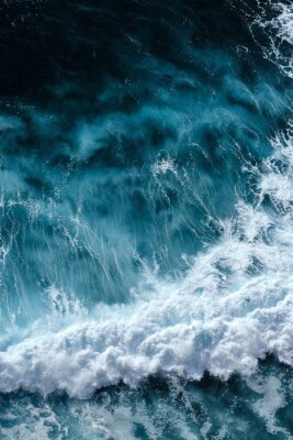 Posters Aerial view to seething waves with foam. Waves of the sea meet each other during high tide and low tide