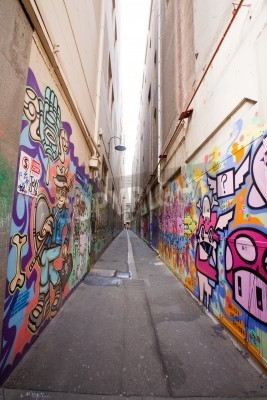 Posters Alley in Melbourne with many graffiti at the wall