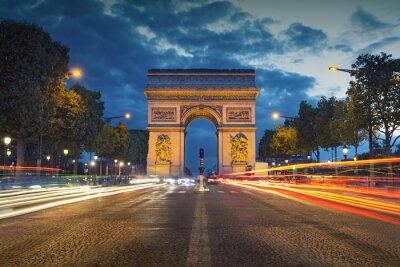 Posters Arc de Triomphe. Image of the iconic Arc de Triomphe in Paris city during twilight blue hour.