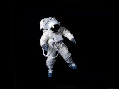 Posters Astronaute flottant sur un fond noir.