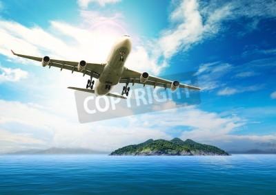 Posters avion de passagers survolant belle bleu océan et l'île en destination de la pureté utilisation de la plage de la mer pour les vacances d'été de vacances treveling