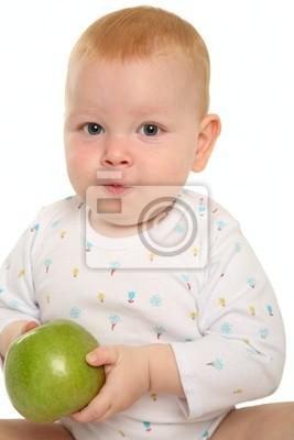 Beau bébé avec une pomme verte.