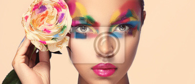 Posters Beautiful girl model with multi-colored paints on her face. Woman with rose flower and bright color make-up. Cosmetics, beauty and makeup.  Spring and summer flowering  shopping