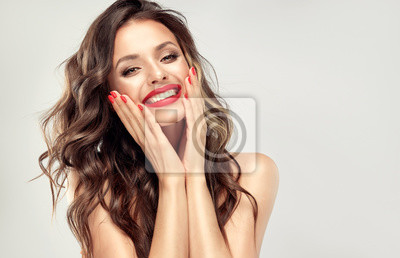 Posters Beautiful laughing brunette model  girl  with long curly  hair . Smiling  woman hairstyle wavy curls . Red  lips and  nails manicure .    Fashion , beauty and make up portrait