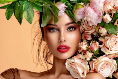Posters Beautiful white girl with flowers. Stunning brunette girl with big bouquet flowers of roses. Closeup face of young beautiful woman with a healthy clean skin. Pretty woman with bright makeup