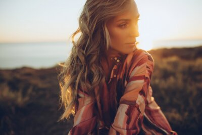 Posters Beautiful woman. Young woman, sunlight, sunset. High quality photo