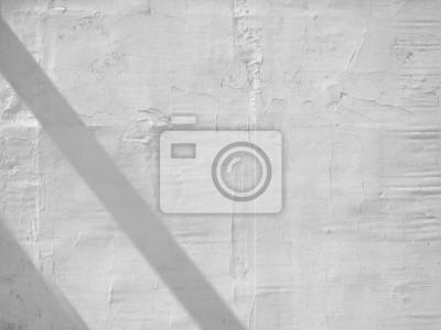 biała ściana z cieniem