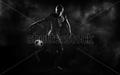 Posters bright soccer playerl on the black background
