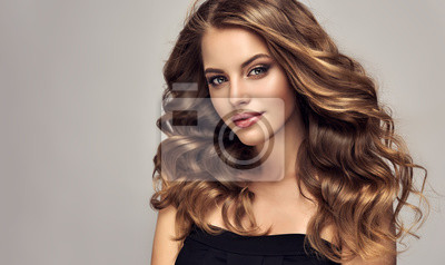 Posters Brunette girl with long and shiny wavy hair . Beautiful model with curly hairstyle .
