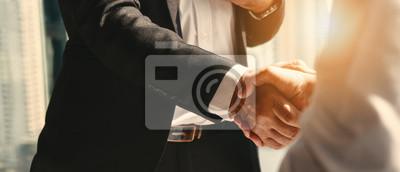 Posters business background of businessman having handshake